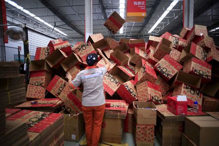 China's E-commerce Gold Rush Is on, and Deliverymen Dig in