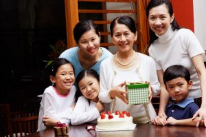 Jewellery in China: Upper middle class Chinese family celebrating parent's birthday